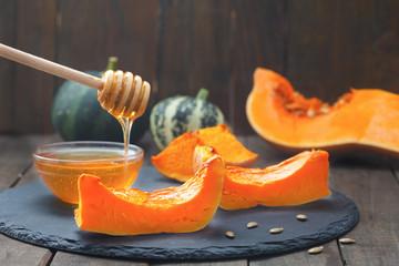 Baked butternut squash with honey. Roasted sweet pumpkin slices. Healthy vegetarian food.
