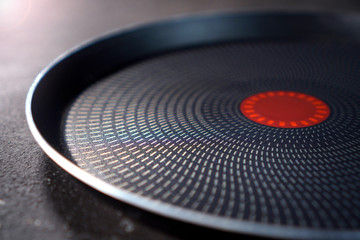Teflon pan with non-stick coating close up on a cuisine table Fotomurales