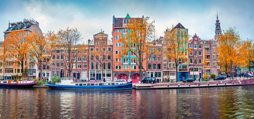 Canvas Prints Amsterdam Panoramic autumn view of Amsterdam city. Famous Dutch channels and great cityscape. Splendid morning scene of Netherlands, Europe. Traveling concept background.