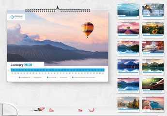 Landscape Calendar Layout with Blue and Red Accents