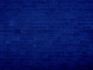 Grunge brick wall blue texture navy blue background.