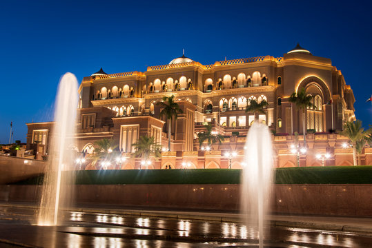 Emirates palace in Abu dhabi reflected on the ground level fountain