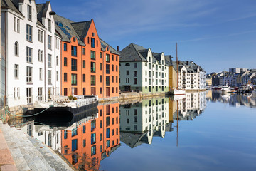 Colorful architecture of Alesund reflected in the water, Norway