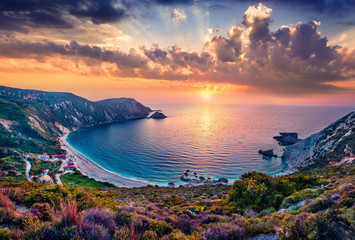 Foto auf Acrylglas Lavendel Unbelievable summer view of Petani Beach. Majestic sunset on Cephalonia Island, Greece, Europe. Beautiful evening seascape of Mediterranen Sea. Fantastic outdoor scene of Ionian Islands.