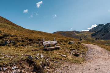 Old wooden bench in the mountains