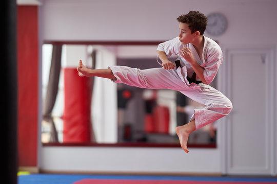 Young karate student executing a kata