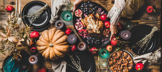 Thanksgiving party table setting. Flat-lay of roasted chicken, vegetables, fig pie, Autumn fruit,...