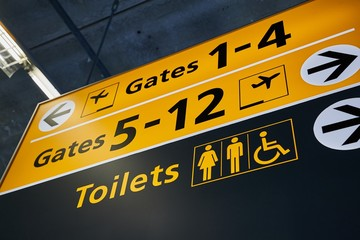 Toilets and gate signs in an airport terminal