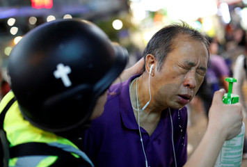 The Wider Image: Sermons with saline: Hong Kong pastor offers aid and prayers