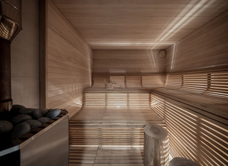 Illuminated wooden sauna with benches and logs