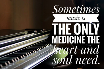 Inspirational words - Sometimes music is the only medicine the heart and soul need. With keyboard background in natural lighting.