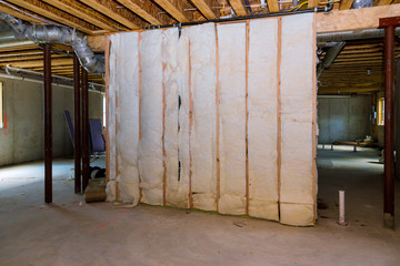 Insulation of basement with fiberglass cold barrier and insulation material