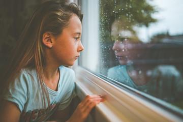 Girl looking through a train window, England, United Kingdom