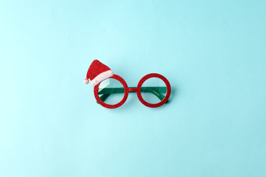 glasses Santa's Christmas on blue background. Masquerade party new year funny sunglasses, trendy minimal winter holiday idea