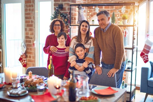 Beautiful family smiling happy and confident. Standing and posing celebrating christmas at home