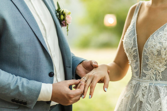 Man wearing wedding ring on woman hand close up. Symbol of love and commitment. Wedding ceremony vows.