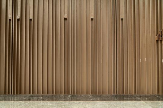 Random wooden strip wall in vertical direction / interior design decoration / background / copy space
