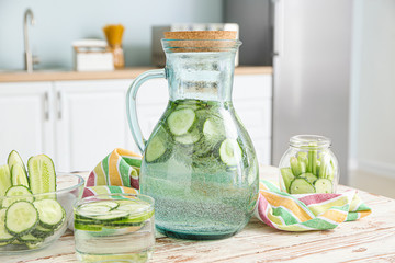 Healthy infused water on table in kitchen