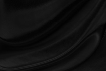 Black gray satin dark fabric texture luxurious shiny that is abstract silk cloth background with patterns soft waves blur beautiful.