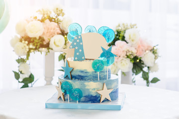 close up photo a blue 3 tier birthday cake for 1 year boy