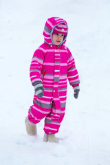 Girl playing outside in winter