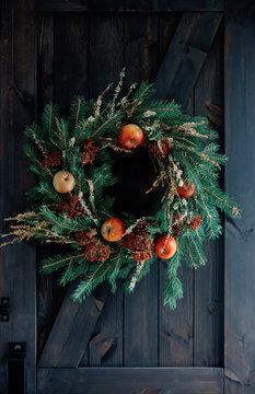 Handmade Christmas wreath hang on a door