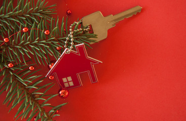 Christmas decoration: decorative house and key to the lock. Concept of finance and housing loans