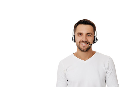 Call center worker man isolated on white background. Young smiling employee telesales agent using headset