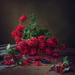 Still life with bouquet of summer's roses and red currant
