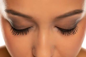 closeup of female natural eyelashes with mascara