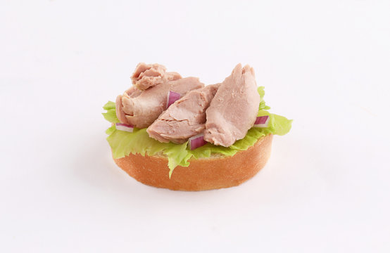 open sandwich appetizer with tuna topping
