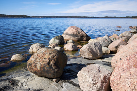 Peaceful summer landscape by the Baltic Sea in Kasnas, Kemio, Finland. Wide angle shot of the rocks on the seashore in the Finnish archipelago.