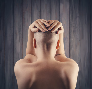Portrait of a hairless woman from back