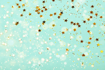 Trendy mint background with golden stars. The concept of celebrations, the Day of St. Valentine, Christmas, New Year, holiday, birthday, etc.