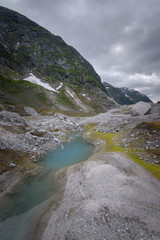 Austerdalen mountain valley with insane colors yellow ble turquoise in Norwegian landscape