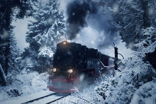 """Historical steam locomotive struggles in the dark, through snow and storm to the mountain """"Brocken"""""""