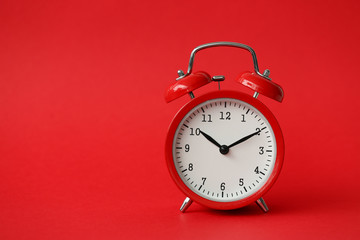 Red alarm clock show 10 hour vintage modern