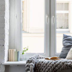 Relax area on wooden windowsill