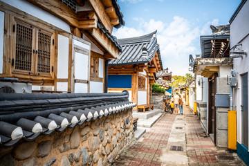 Laneway in Gyeongju with old Korean houses and dramatic light Gyeongju South Korea