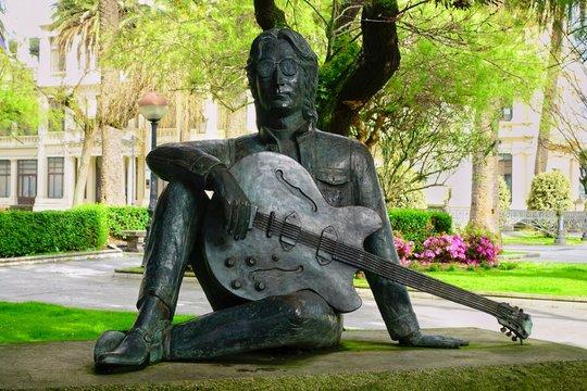 CORUNNA, SPAIN - APRIL 01, 2018: John Lennon statue in Jardines de Mendez Nunez. CORUNNA is famous touristic city and municipality of Galicia, Spain.