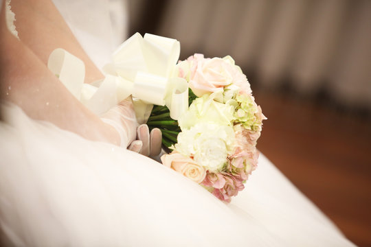 a bouquet in the hands of the bride