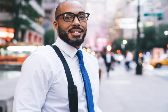 Positive ethnic employee looking at camera