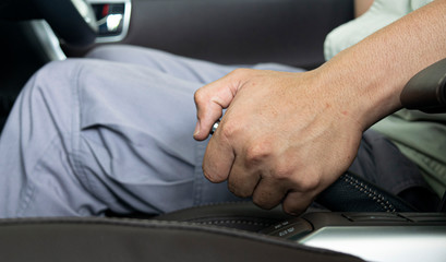 Male hand pulling a parking brake / Using a hand brake lever