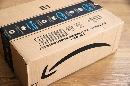 WARSAW, POLAND - AUGUST 23, 2019: Amazon Prime online store order delivered package in Europe. Amazon is considered one of the Big Four global tech companies.