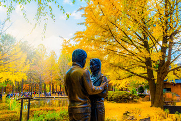Foto op Canvas Meloen Statue and Tourists taking photos of the beautiful scenery around at Nami Island in seoul,South Korea,19 November 2019.