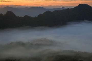 mountains under mist in the morning