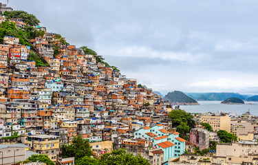 Acrylic Prints Brazil Brazilian favelas on the hill with city downtown below at the tropical bay, Rio De Janeiro, Brazil