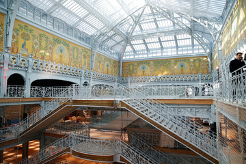 A general view shows the hall and the staircase with Art Nouveau decoration inside French Samaritaine department store in Paris