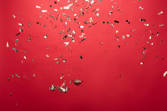 view of golden christmas confetti isolated on red