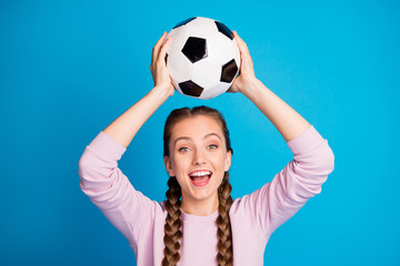 Close up photo of cheerful funny youth hold foot ball watch league world cup match feel crazy excited wear casual style clothing isolated over blue color background